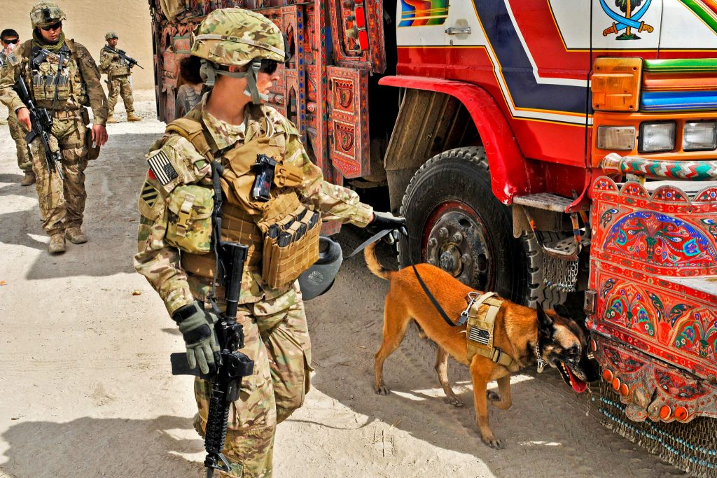 US military personnel searching a truck on the Pak-Afghan border