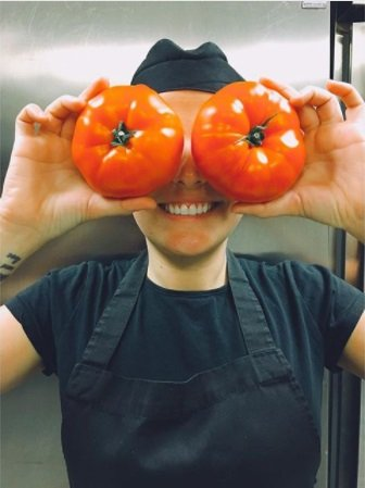 Bianca playing with tomatoes. Waitress life.